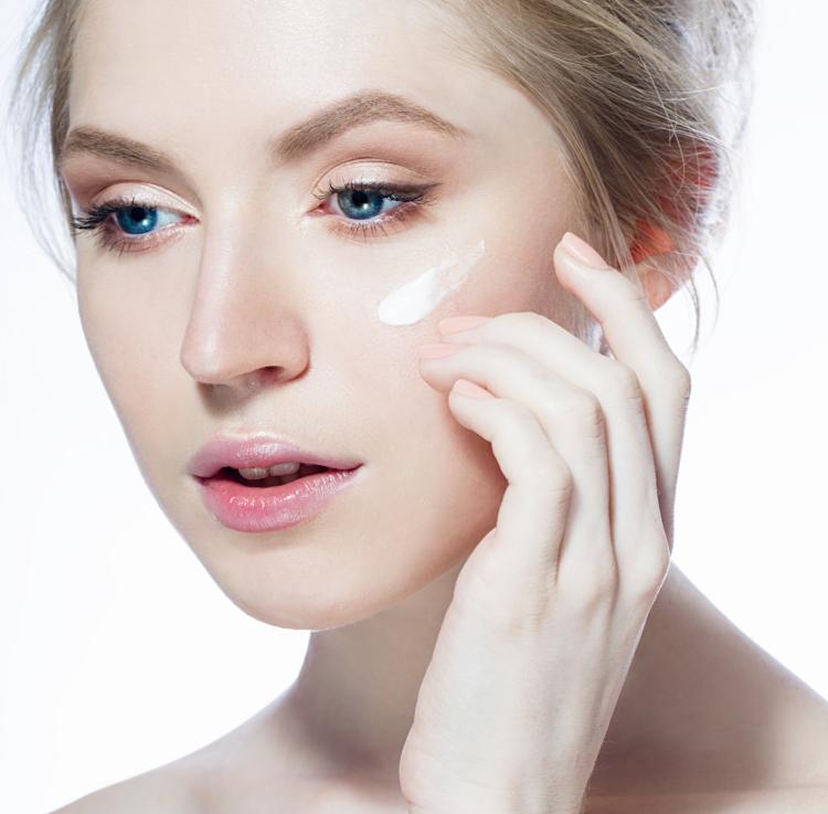 Woman-applying-cream-on-the-face-000054397380_Full (1).jpg