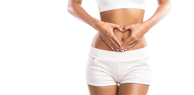 fit-young-woman-holding-a-heart-over-her-abdomen-isolated-on-white-background-838511984_6016x4016-e1569549724226.jpeg