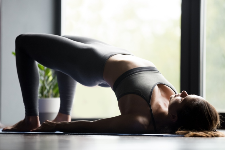 Young-sporty-woman-doing-Glute-Bridge-exercise-1042985104_3869x2580.jpeg