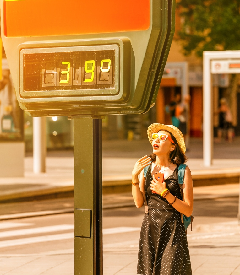 Woman-suffers-from-heat-and-sunstroke-outside-in-hot-weather-on-the-background-of-a-street-thermometer-showing-39-degrees-Celsius-1144729101_2632x3019.jpeg