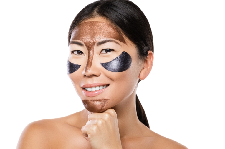Young asian woman with a purifying peel-off mask on her face